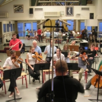 Lionel Rokita conducting the orchestra at the Conservatoire during recordings